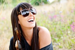 Image: Woam smiling in sunglasses. Motivation blog from Lucy Stanyer Life Coach