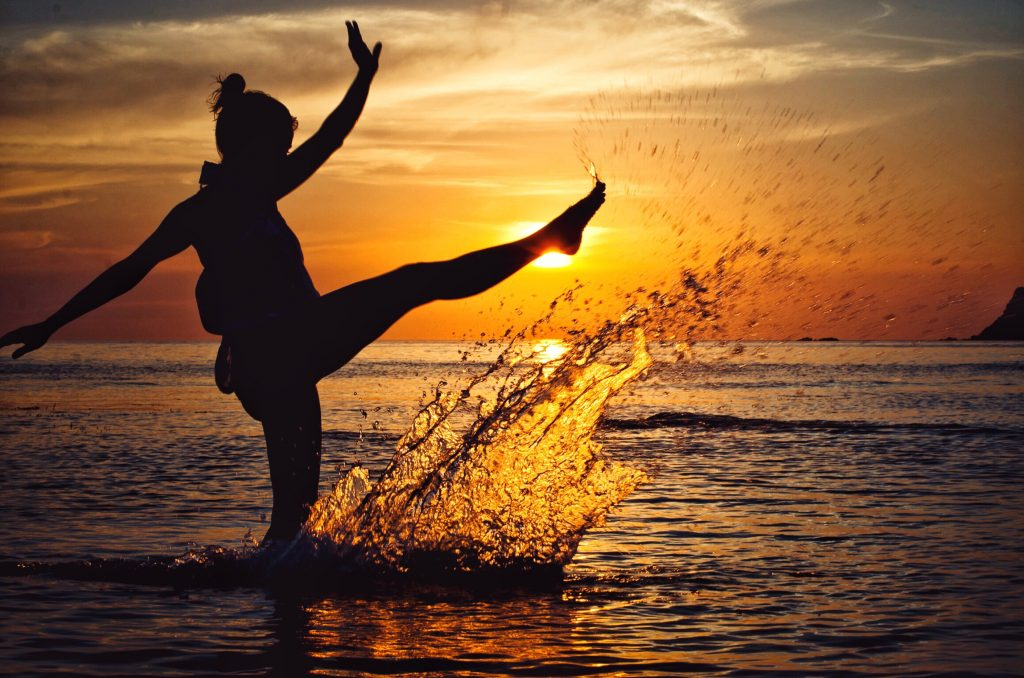 How to get your business mojo back - Blog post by Lucy Stanyer Life Coach www.lucystanyerlifecoach.com/blog [Image: woman splashing water at sunset]
