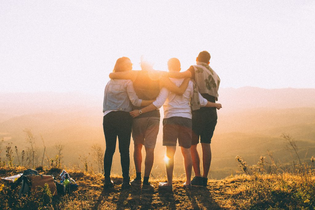 friends with arms round each other - blog about taking more care of your life